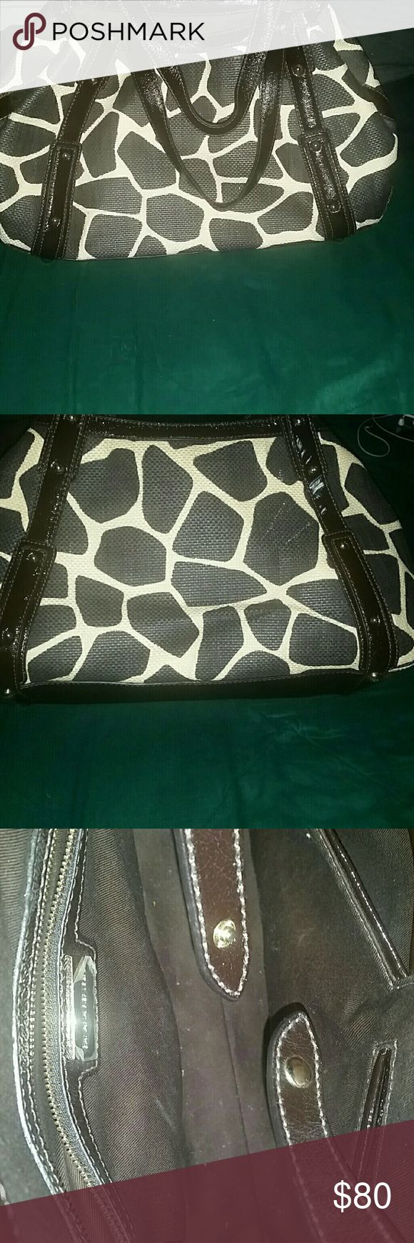 Banana Republic Giraffe Print Bag Great Condition aside from Paint scuff mark.  probably can be removed but I don't want to ruin it. So selling as is price negotiable Banana Republic Bags Totes