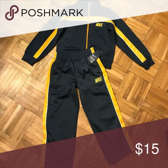 Nike jogging suit BNWT Nike jogging suit. Navy blue with yellow lines in a small white line. Nike Matching Sets