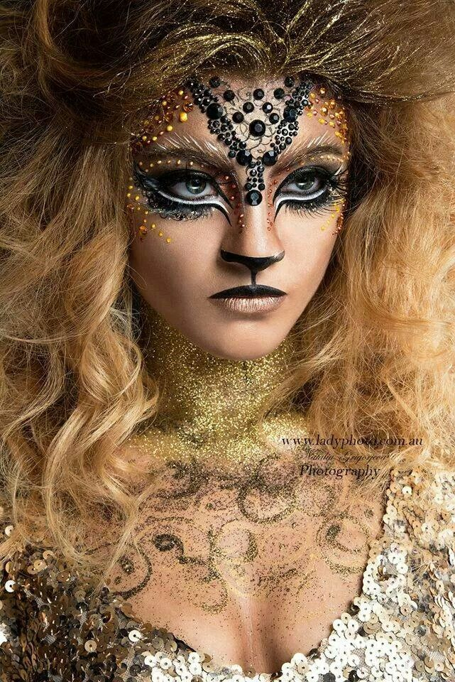 A beautiful woman subverting nature by transforming herself into something into a dream of something between human and animal, more precious than a lioness and more fierce than a woman. Makeup, art, costume, hair.