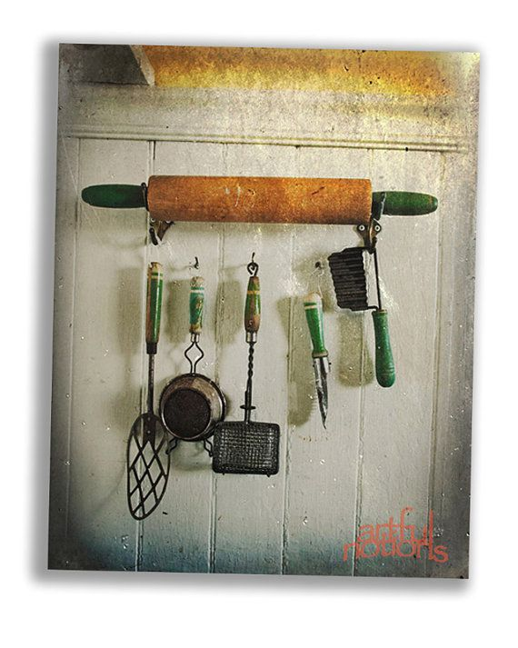 Old kitchen utensils hanging from an old rolling pin