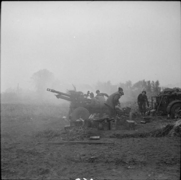 THE BRITISH ARMY IN NORTH-WEST EUROPE 1944-45.   25-pdr field guns in action during the advance on Hertogenbosch, 23 October 1944.