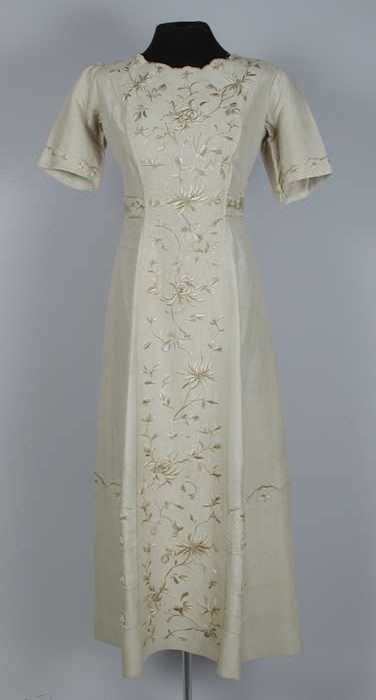 Embroidered beige silk walking dress (without matching jacket), by Ms. Lewis Leonard Humason, American (California), 1910-12.