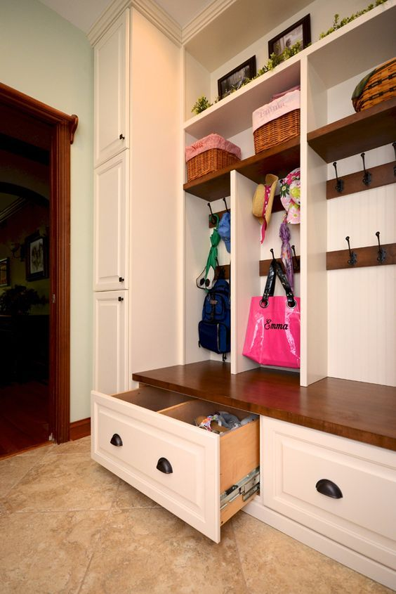 open shelving and drawers for mudroom storage