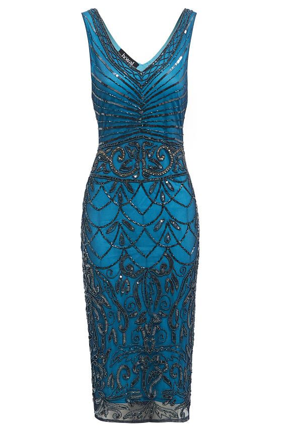 Elegant blue embellished sequins dress. The design graduates into a flowing skirt, highlighting the waist and creating a figure flattering effect. A perfect pick for a 1920s Gatsby-themed party or elegant cocktail do, this dress wont let you down this festive season. Product Information