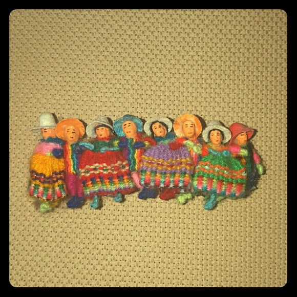 Hand Made Worry Doll Barettte Peru Worry dolls are designed as miniatures of the traditionally dressed indigenous people of the Andes mountains. Peruvian children believe that before you go to bed at night, you tell one worry to each doll. Put the dolls under your pillow and when you get up in the morning, your worries are gone. These barrettes are decorated with worry dolls in true Andean fashion.   Never used, but there is some dust in the crevices due to being in storage and residue…