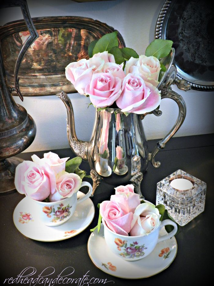Repurpose a thrift store tea pot and cups by adding fresh flowers and displaying.
