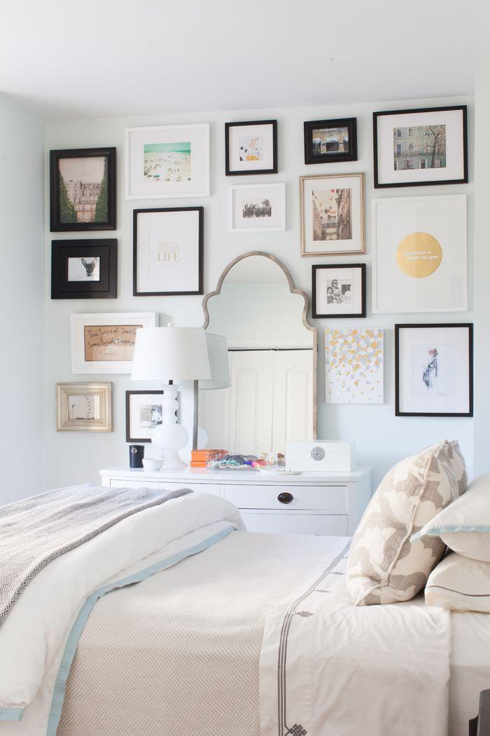 Gallery wall around dresser mirror