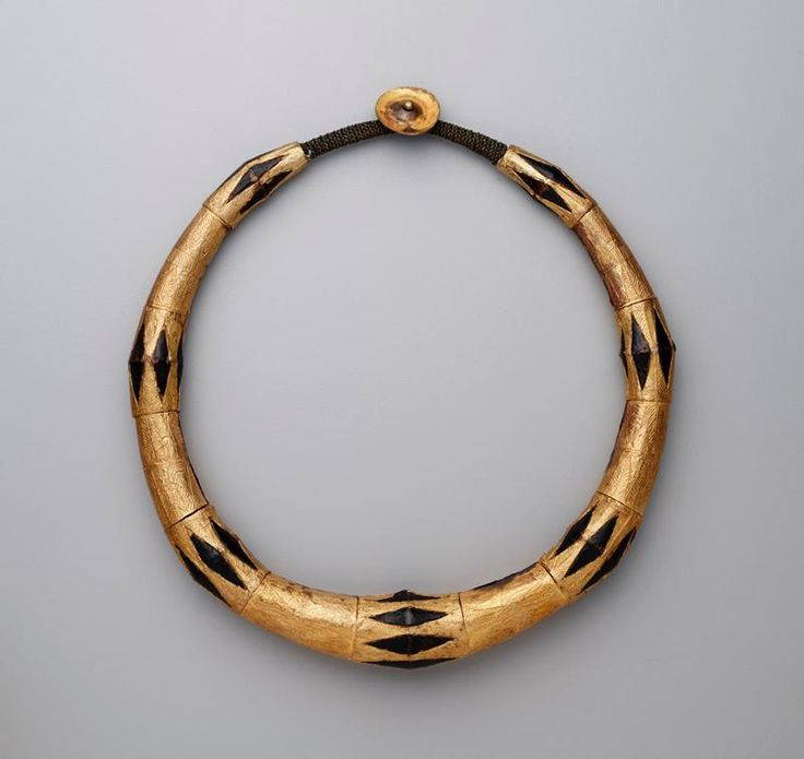 Indonesia | Man's necklace (kalabubu). Wood, gold, gold leaf and possibly brass | 19th century