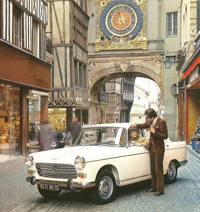 Peugeot 404- the early 1970's I'm assuming (judging from the guys suit!) if you know better please let me know