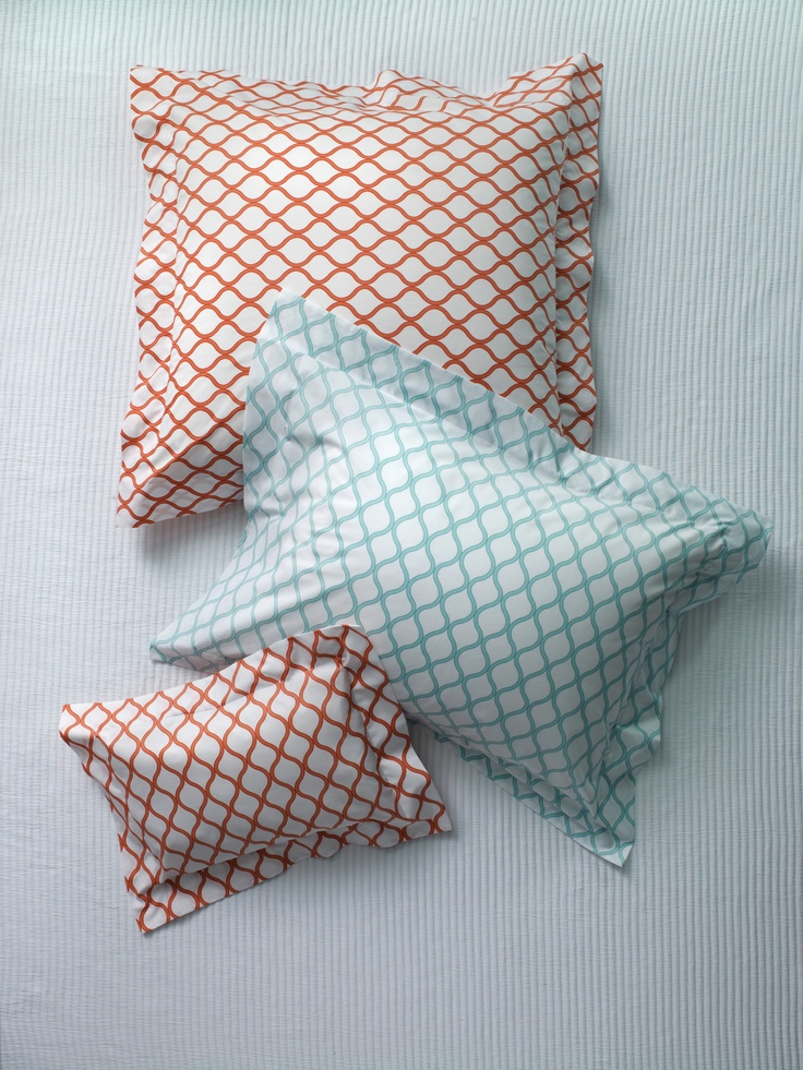 Andover Aqua and Salmon colored Italian-woven and -printed bedding from SFERRA.
