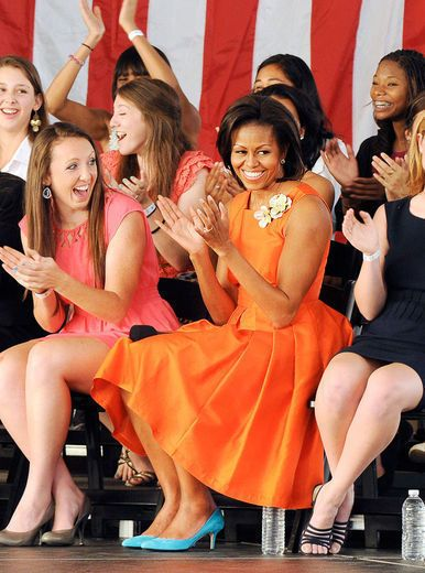 The First Lady, Michelle Obama always hits a homerun especially in this tangerine dream A line dress and more.