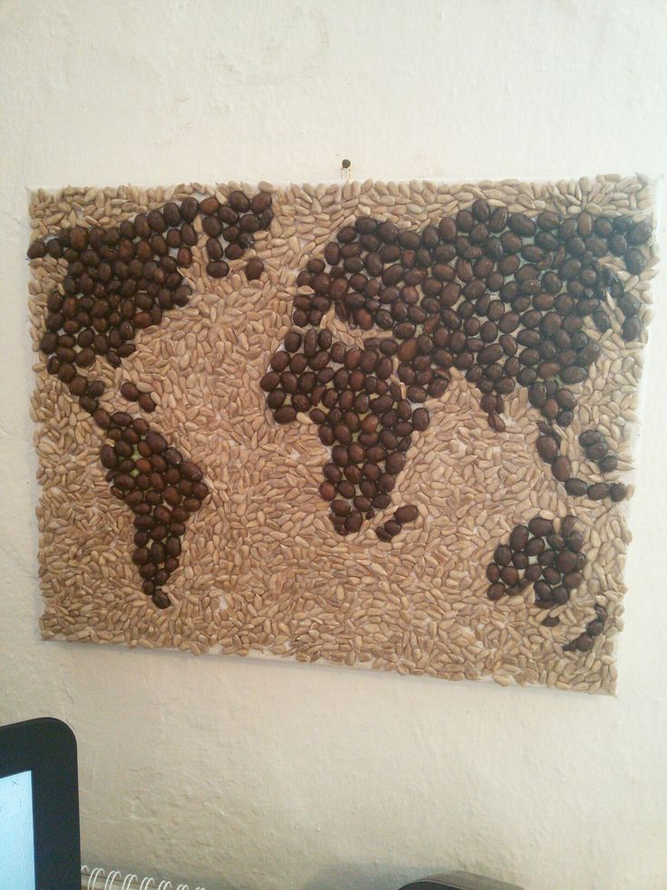 Beautiful handmade picture made of coffee and sunflower seeds.