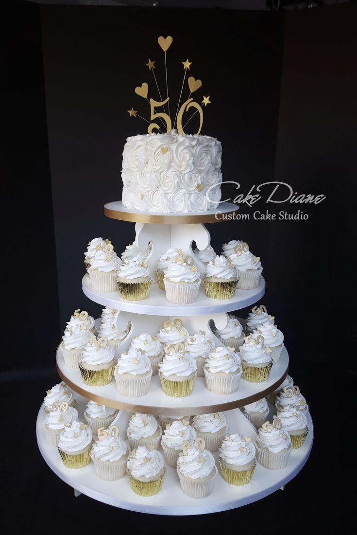 Golden 50th anniversary cupcake tower with rosette top for 50th birthday cake decoration ideas
