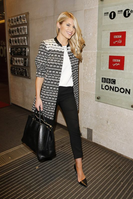 Mollie King was seen out and about dressed in a classic black and white ensemble. I'm loving her black and white graphic coat