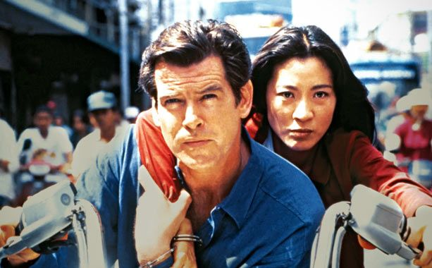 15. Tomorrow Never Dies (1997)  Box Office: $125.3 million/$339.5 million  Director: Roger Spottiswoode  Theme Song Performed By: Sheryl Crow