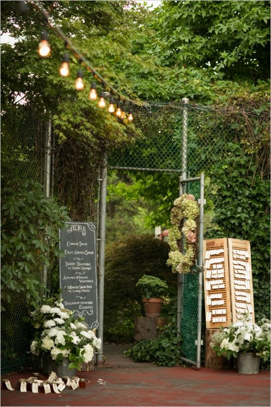 Dinner on the tennis court with string lighting ideas. Captured By: Erica Chan Photography http://www.weddingchicks.com/2014/06/20/handcrafted-barn-wedding-2/