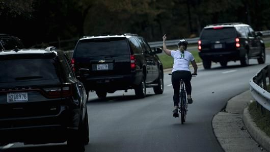 GoFundMe page for Juli Briskman, the woman who was fired from her job because she gestured with her middle finger as a motorcade with US President Donald Trump departs Trump National Golf Course October 28, 2017 in Sterling, Virginia.