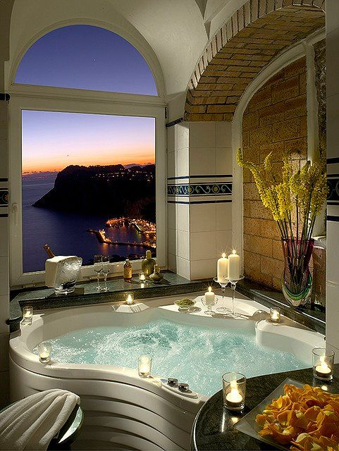 A relaxing jacuzzi tub with a view of Capri, Italy