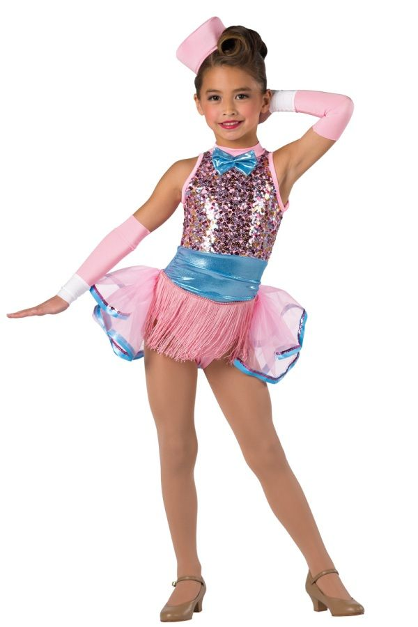 Style# 17122 COULD IT BE MAGIC  Multi-color sequin on pink mesh and pink spandex leotard with copen foil printed spandex cummerbund insert. Attached fringe skirt and separate chiffon bustle. Bow, ribbon and sequin trim. Headpiece and mitts included. XSC-XXLA