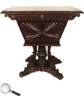 A rosewood tea-poy with sunburst carving on the sides, with a hinged top and a pedestal base with paw feet.     30 in L x 18 in B x 30 in H