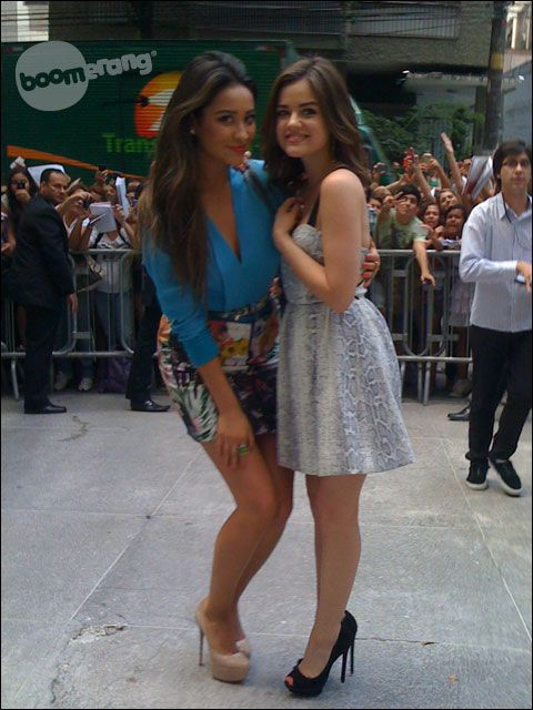 Shay Mitchell and Lucy Hale. I love how Shay has to bend down to be the same height as Lucy :)