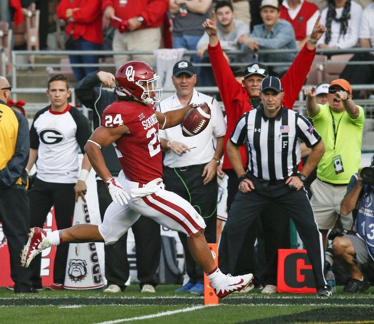 Oklahoma's Rodney Anderson (24) rushes for a touchdown in ...