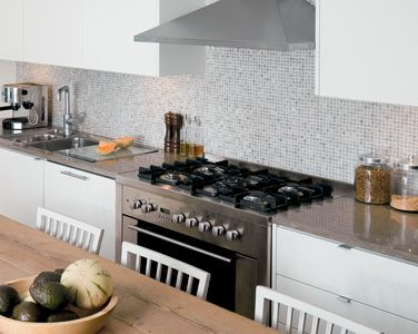 Tulikivi Cloudy Grey mosaic on the wall and Azul Cascais on the counter tops.