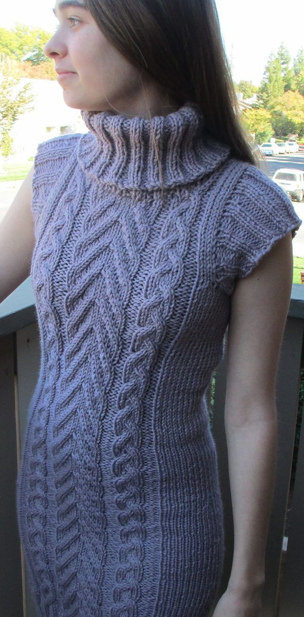 """Knitting Pattern for Roam Tunic - A slim fit and kangaroo pocket streamlines the cables of this sweater. Finished Size 30½ (35½, 40½, 45¼, 50¼)"""" bust circumference. Tunic shown measures 30½"""". Pictured project by stitch-please"""