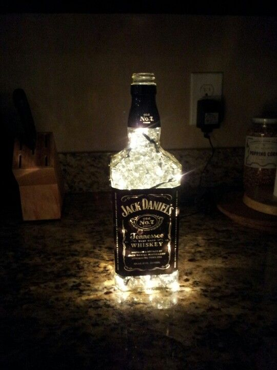 Jack Daniels Lamp...drill hole in the back w/ a diamond drillbit, stuff lamp w/string light (I used 50 count), add small clear marbles
