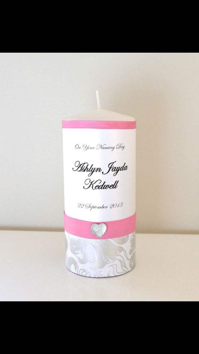 Half Size Naming Day Candle custom design by Flickering Moments. This has a floral silver wrap trimmed with gorgeous pink ribbon and diamanté love heart . Can be personalised to include any name and date.
