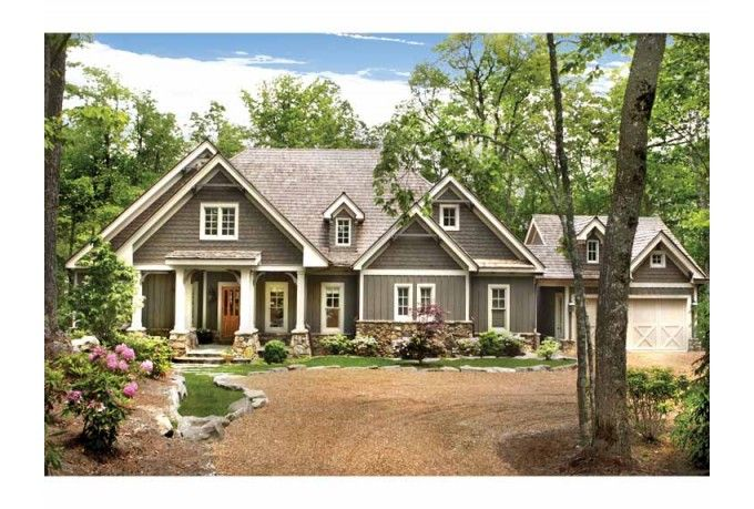Ranch exterior with character touches like the pillars and Craftsman style gables