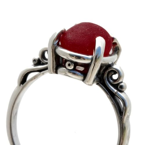 A stunning beautiful piece of vivid cherry red sea glass from England set in a silver ring.