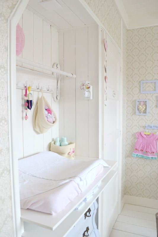 We love the white wood slats of this recessed changing table, which give it a country feel.