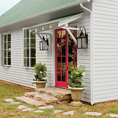 back porch idea, love the overhang, red door, lights on either side.