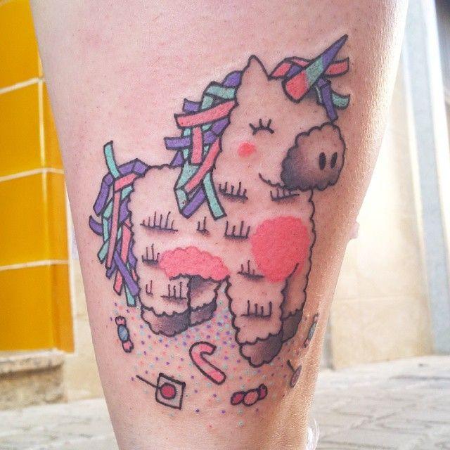 unicorn piñata tattoo