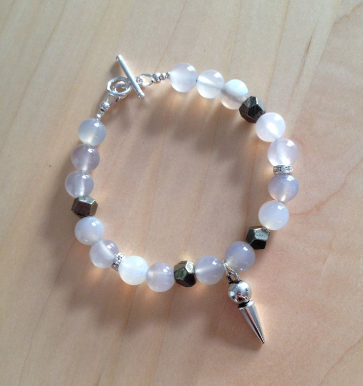 Grey Agate and Pyrite Spike Bracelet (MGB72) $38.00  Beads are strung onto strong and flexible beading wire with a sterling silver toggle clasp closure. Great for layering or simply wear it on it's own. Fits a 6-7 inch wrist.