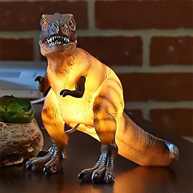 Goodness Cretaceous, great balls of fire! Our pterobley awesome Tyrannosaurus Rex Table Lamp is just dying to meat you!  This ferocious predator of light (aka dinosaur lamp) effortlessly crushes darkness. No longer will you need to sleep with one eye open, as this Lizard King is on guard to protect you from the monsters under your bed, and that pesky creeper known as Mr. Sandman.