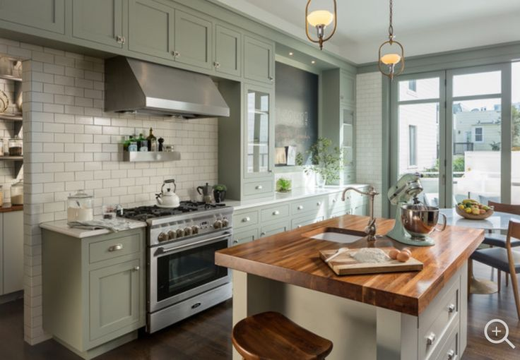 Green cupboards with white subway tile