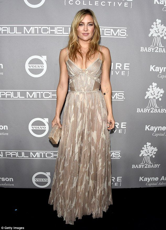 Golden goddess: The actress rocked a shiny nightie-inspired number at the event held at 3L... Kate Hudson