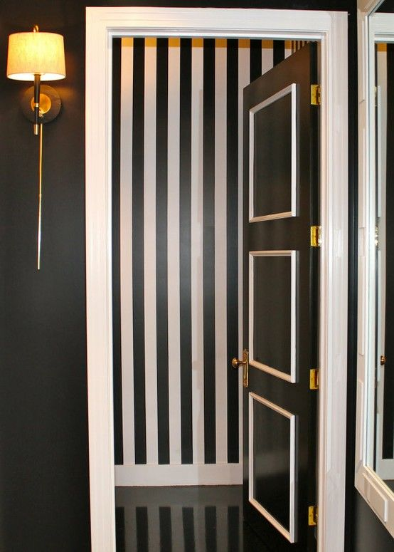 This door is fabulous! I love the bold, dramatic look theyve achieved with paint and just a little bit of trim. You could use white paint instead of the trim for a similar look.
