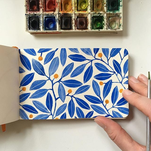 Instagram media by kirstensevig - Painted this pattern on the airplane yesterday, flying from Vegas to Minneapolis. #handbookjournal #travelogue #watercolor #pattern #blueleaves #leavesandberries #painting