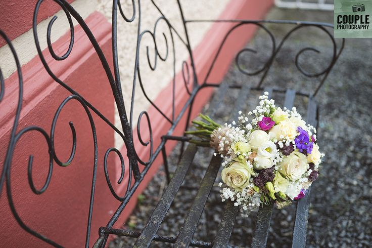 The bouquet sits on the love seat outside the bride's house.Wedding at Summerhill House Hotel by Couple Photography.