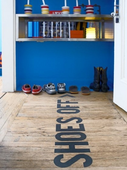 SHOES OFF letters on the floor
