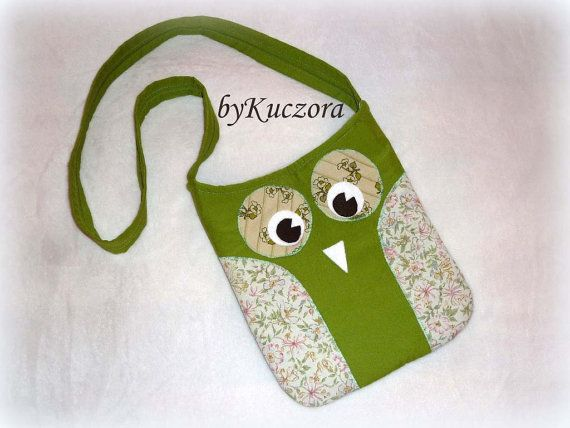 This medium sized owl tote bag is perfect for everyday use.  The item was made from cotton fabric and felt.  The tote has a magnetic clasp to keep bag closed.  The inside of the bag is fully lined and features 2 small sized pockets for your phone, keys, pens, napkins, and other small things