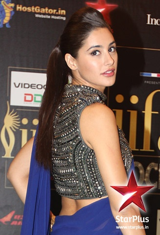 Nargis Fakhri wears an indigo sari with a detailed embroidered blouse at #iifa