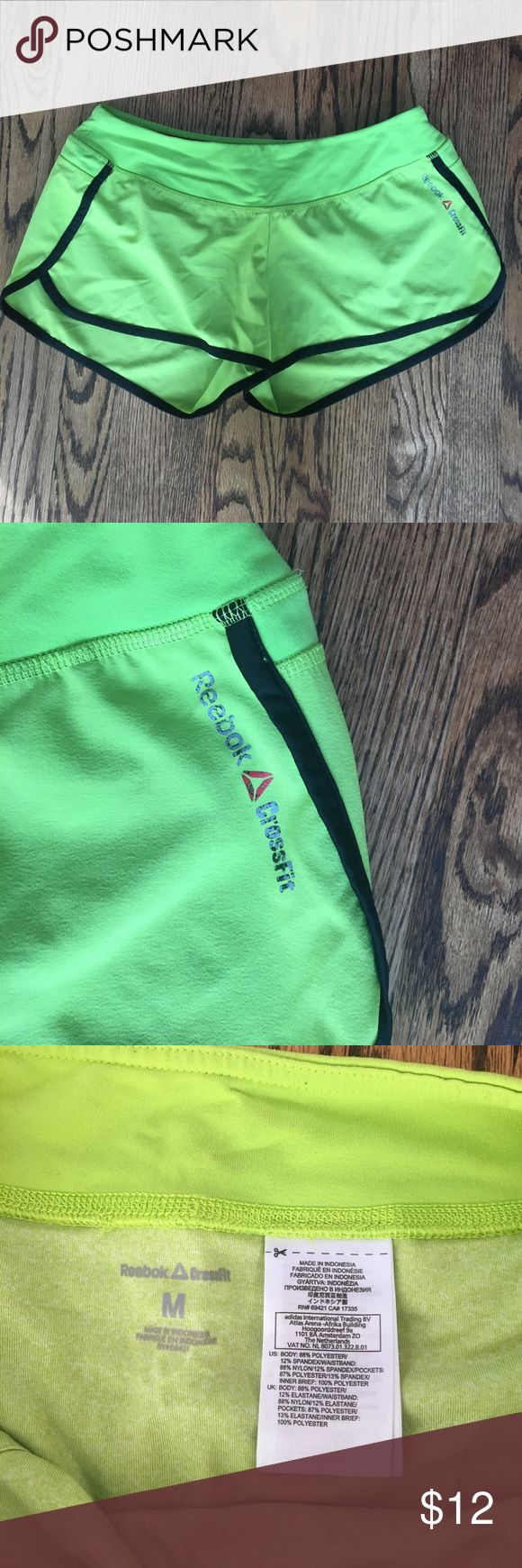 Reebok crossfit lime shorts size M Lime green athletic shorts. Perfect for running or cross training. Great condition. Reebok Shorts