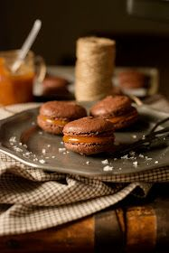 Chocolate macarons with caramel filling