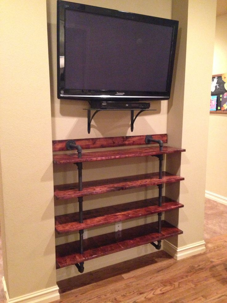 Pipe and wood bookshelf DIY entertainment center