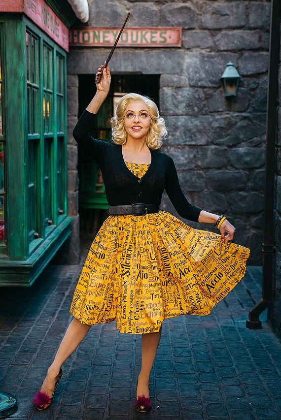 1950s-style Hufflepuff dress. The print is a mix of the spells from Harry Potter in the Potter-style font.