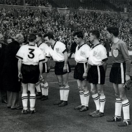 CUP FEVER: The 1959 Crook Town team meeting the dignitaries before the FA Amateur Cup final.